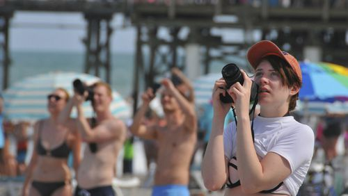 Sightseers capture the launch on camera. (AAP)