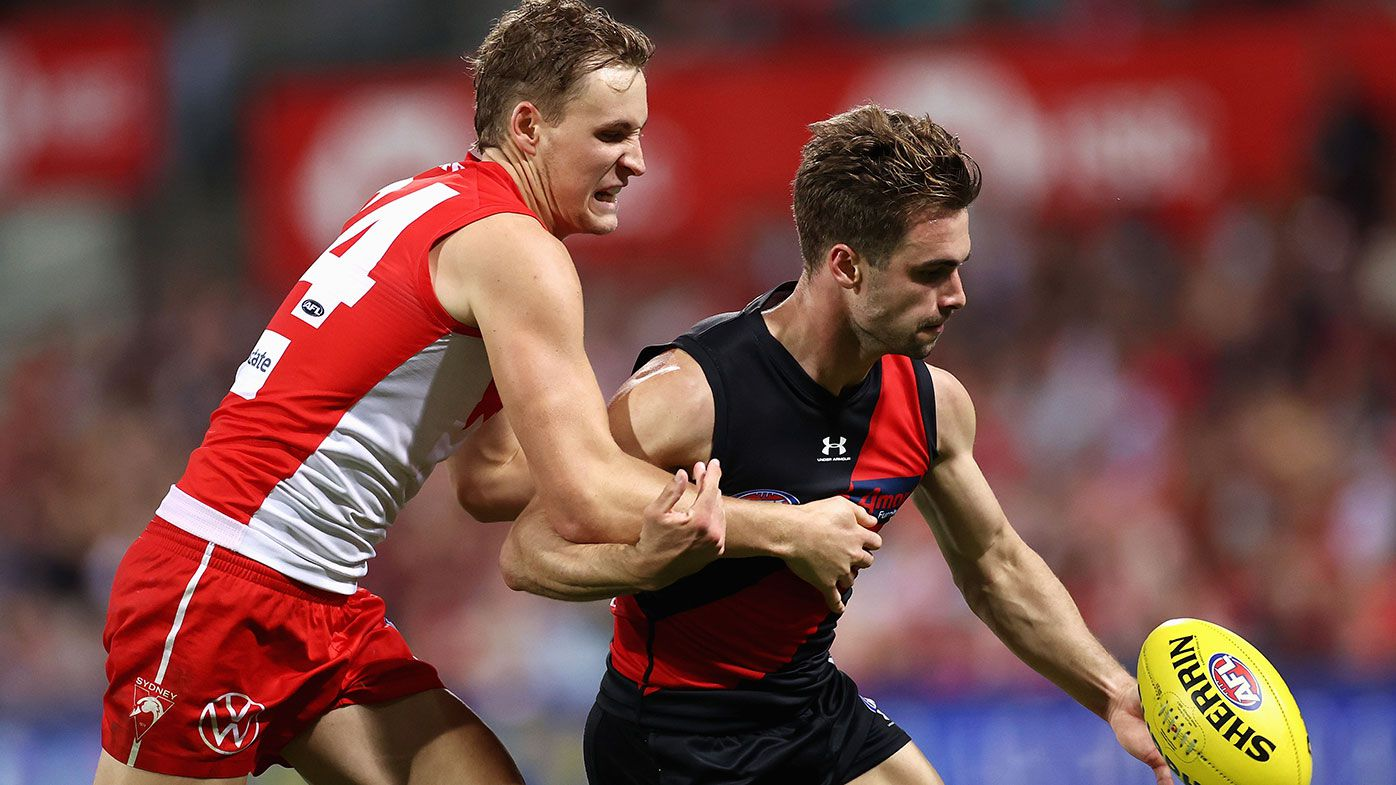 Will Snelling of the Bombers is tackled by Jordan Dawson of the Swans during the round four AFL match between the Sydney Swans and the Essendon Bombers at Sydney Cricket Ground on April 08, 2021