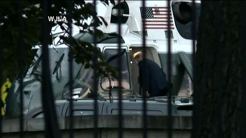 After giving reporters a thumbs up, Mr Trump boarded Marine One.