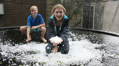 """<p>Rohan and Caitlin Stroud welcomed the cool change at Browns Plains at 5pm. (Supplied, Kelly Stroud)</p><p><strong>Send your storm photos to <a href=""""mailto:news@9news.com.au"""">news@9news.com.au</a>and remember to stay safe and dry.</strong></p>"""