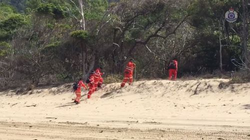 Police and SES continue to search the beach.