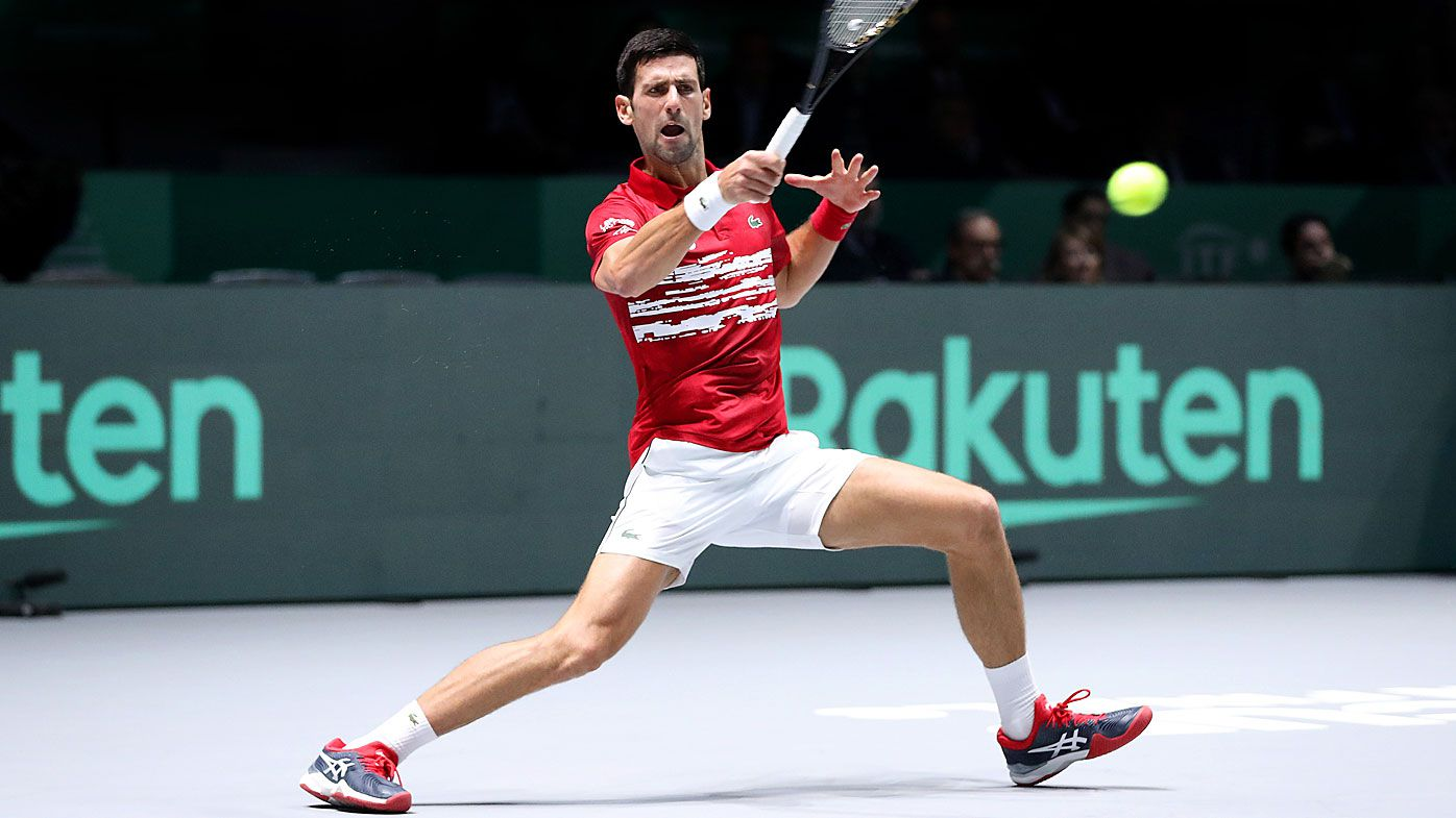 Novak Djokovic of Serbia plays a forehand shot during his Davis Cup group stage match against Yoshihito Nishioka