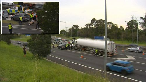 A man died after being struck by a truck on the Brisbane motorway. (9NEWS)