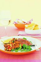 Seasoned fish fillets with cucumber and corn salsa