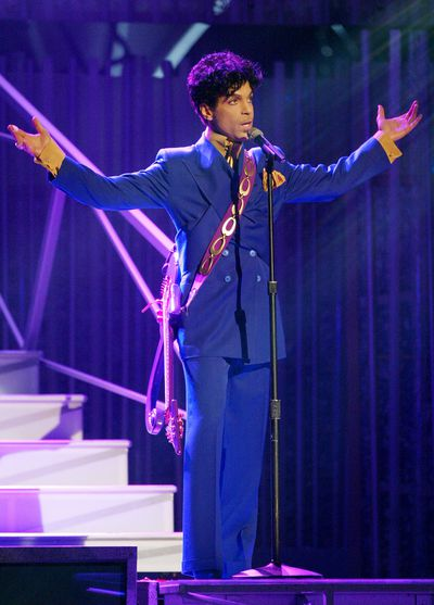 Prince performs the song 'Purple Rain' at the 46th Annual Grammy Awards held at the Staples Centre in 2004.