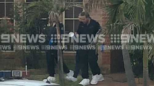 Police visit the girl's home. (9NEWS)