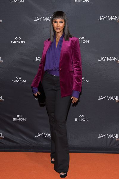 In purple shirt and maroon blazer, Iman stands tall and looks gorgeous as ever.