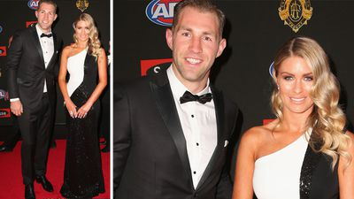Collingwood star Travis Cloke's partner Rebeccah Panozza made sure she matched his team colours. (Getty)
