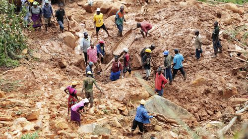 A family dig for their son who got buried in the mud when Cyclone Idai struck in Chimanimani about 600 kilometres south east of Harare, Zimbabwe, Tuesday, March, 19, 2019.