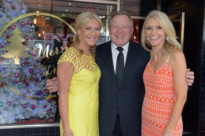 The thorn between the roses? Peter poses with colleagues Jo Hall and Livinia Nixon.