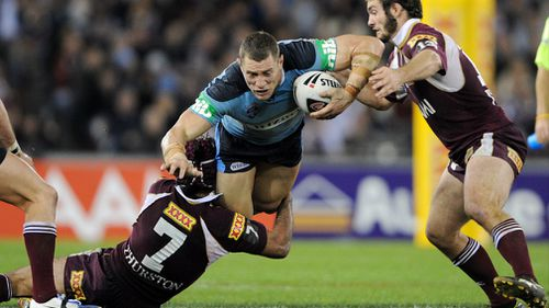 New South Wales' Luke O'Donnell is tackled by Queensland's Johnathan Thurston and Dallas Johnson in the first game of the 2009 State of Origin series. Picture: AAP