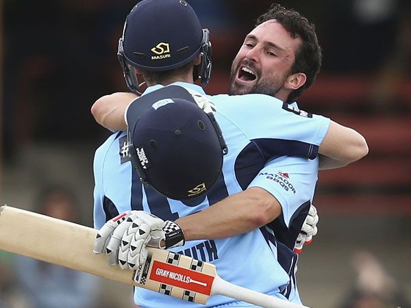 Steve Smith (L) and Ed Cowan celebrate after hitting the winning runs for NSW. (Getty)
