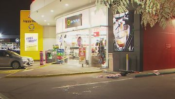 The man was found with life-threatening injuries at a service station.