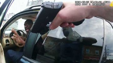 George Floyd is confronted by police shortly before his death, as seen in bodycam footage.