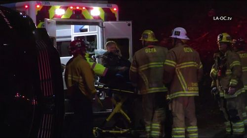 Actor Will Ferrell loaded into an ambulance after a shocking crash in California. (ABC US)