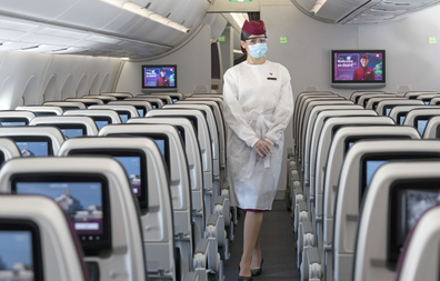Qatar Airways coronavirus measures: cabin crew wear protective gowns, masks, glasses and gloves