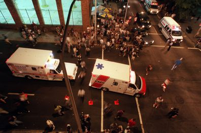 Ambulances arrive at the scene, after three bombs went off in Centennial Park, Atlanta.
