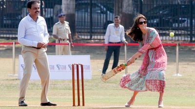 Former India captain Dilip Vengsarkar keeps as Kate bats during the charity match.