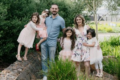 Samantha (right) with her twin Alexandra, parents and siblings.
