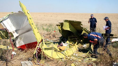 Investigators made slow progress at the site, often having to leave due to shelling. (AAP)