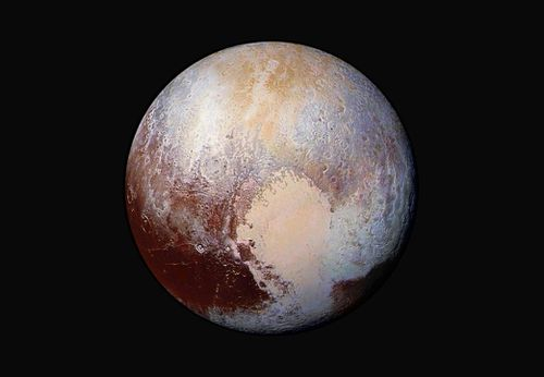 This image made available by NASA on July 24, 2015 shows a combination of images captured by the New Horizons spacecraft with enhanced colors to show differences in the composition and texture of Pluto's surface