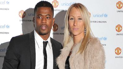 Patrice and Sandra Evra arrive at the Manchester United 'United for UNICEF' gala dinner at Old Trafford, Manchester.