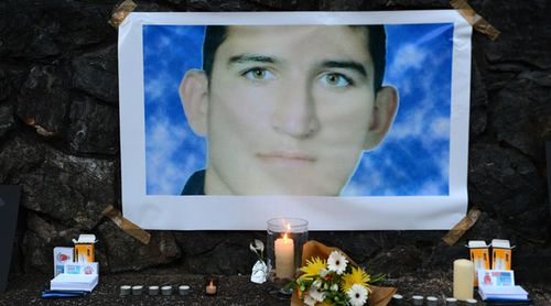 A shrine under a photo of deceased detainee Reza Berati, who was killed on Manus Island. (Supplied)