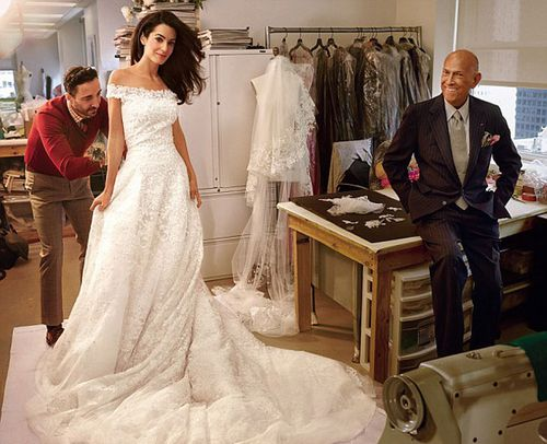 Oscar De La Renta poses at the final wedding dress fitting of Amal Clooney, who wed in Venice this month. (Vogue)