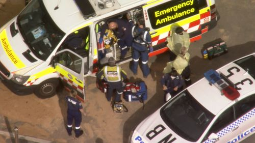 Emergency teams attend to the injured surfer, said to be in his 40s.