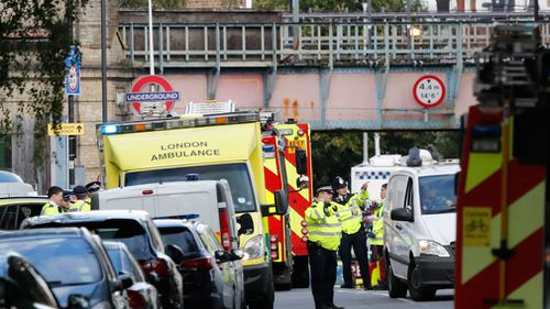 Ambulances and police stand nearby after the explosion on a tube train at Parsons Green subway station in London. (Image: AAP)
