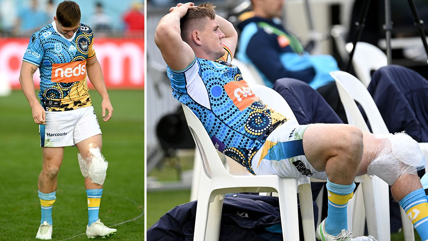 AJ Brimson of the Titans is seen with his knee in an ice pack after being injured during the round 12 NRL match between the Cronulla Sharks and the Gold Coast Titans at C.ex Coffs International Stadium, on May 30, 2021, in Coffs Harbour, Australia. (Photo by Bradley Kanaris/Getty Images)