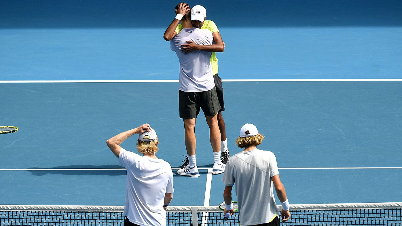 Joe Salisbury of Great Britain and Rajeev Ram of the USA celebrate after winning the men's doubles final against Luke Saville and Max Purcell