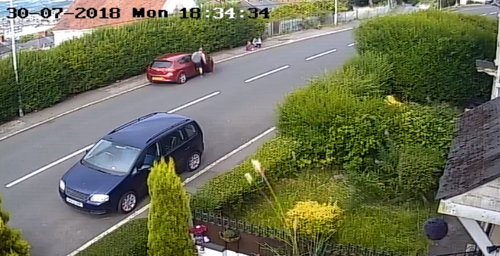 In the footage the driver is seen returning to his car and driving off after checking on the child.