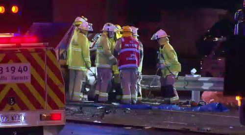 Emergency crews working to clean up the scene in Ipswich Rd last night. Picture: 9NEWS