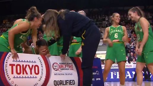 Opals gather around Liz Cambage as she breaks down in tears of relief.