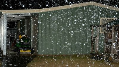 Snow falling outside a home in Canberra early this morning. (9NEWS)