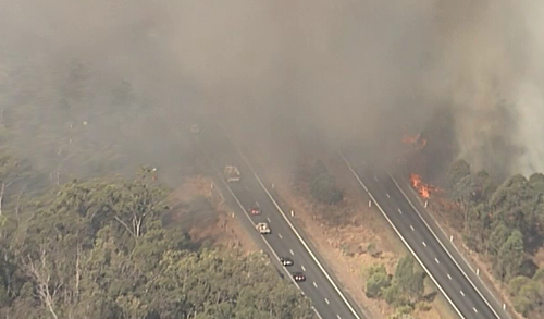 The large fire was travelling from Phillips Road in Grantham and has now crossed the Warrego Highway.