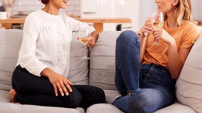 Two female friends drinking wine