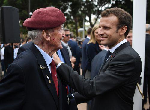 President Macron speaks with Legion d'Honneur awardee Bill Mackay. Picture: AAP