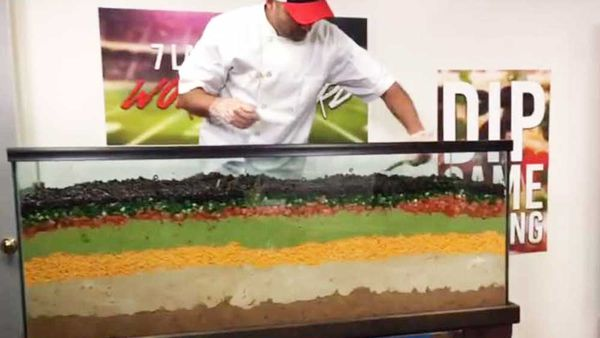 2 The Rock's Guinness World Record breaking Super Bowl dip. Image: YouTube/Guinness World Records