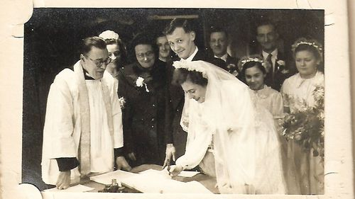 Mr Cooper on his wedding day with his bride May, who he met at the pictures when she was 14.