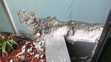 Multiple cracks were found on level 10 of the residential building.