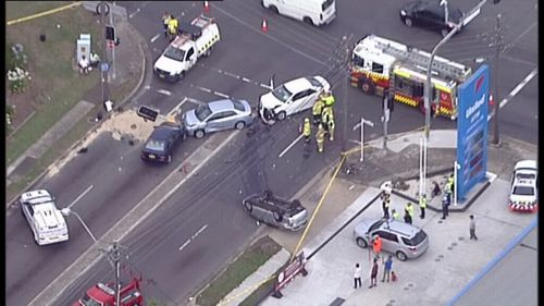 Three people injured after four car crash at Yagoona, in Sydney's south west