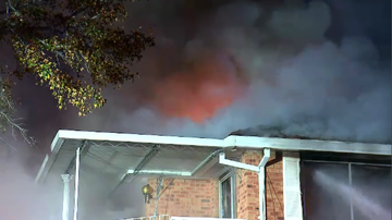 A fire completely engulfed the second storey of a home in Sydney's west early this morning.