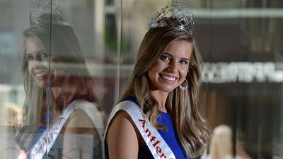 The newly crowned Miss Universe Australia Tegan Martin poses for photos wearing a diamond crown worth $150,000 in Brisbane in July. (AAP)