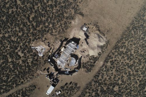 An aerial view shows a makeshift compound in the desert area of Amalia, N.M.