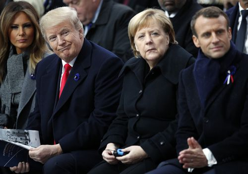 President Donald Trump, German Chancellor Angela Merkel and French President Emmanuel Macron attend ceremonies at the Arc de Triomphe in Paris.