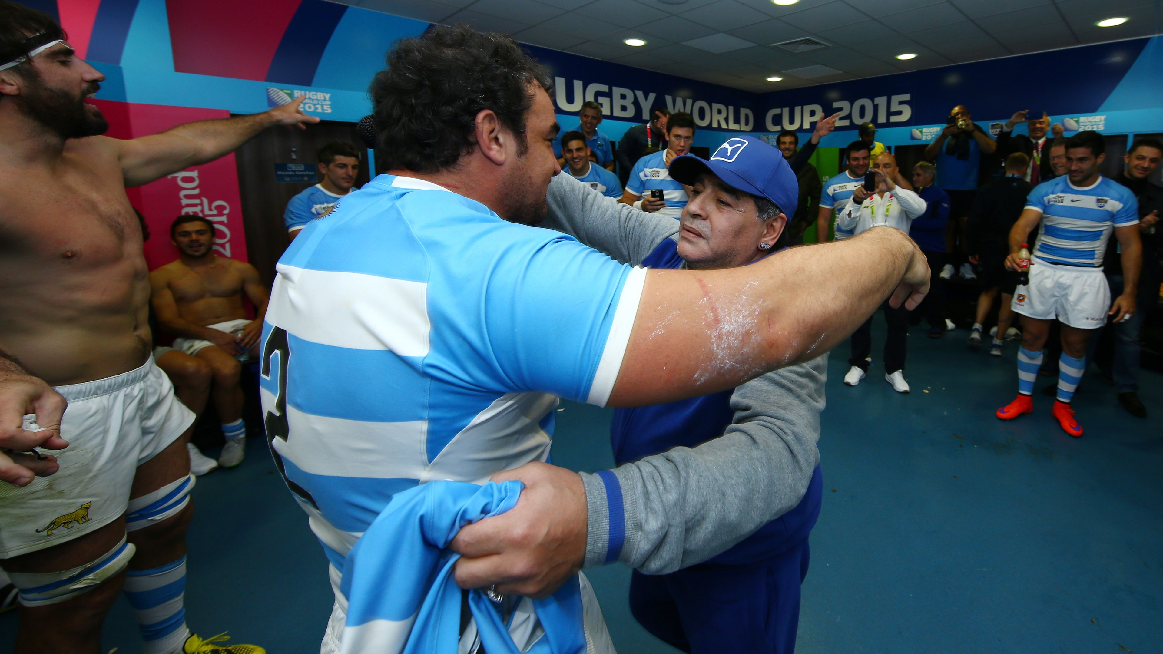 Diego Maradona embraces Argentina captain Agustin Creevy at the 2015 Rugby World Cup.
