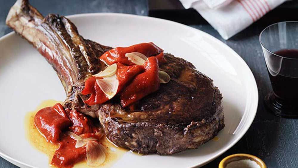 Wood-roasted rib-eye of beef with piquillo peppers for Gourmet Traveller