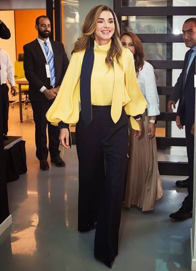 <p>Queen Rania of Jordanhas once again claimed the crown when it comes to being the world'smost stylish royal.</p> <p> The First Lady of Jordan hit all the right style notes while in Amman  to launch an education platform for the Edraak initiative.</p> <p>The mother of four wore wide-leg black trousers and a buttercup yellow turtleneck blouse with bell sleeves. To finish off her polished look, Her Majesty sported black pointed-toe heels and her signature Apple Watch.</p> <p> Hitting all the right style notes, the mother of four sported a white balloon-sleeved blouse from Jordanian designer Maison Makaraem, along with a stunning accordion-pleated Sacaiskirt in olive and gold, staying true to her chic and modern aesthetic.</p> <p> </p> <p> Whether she's reforming her country's education system or attending an international gala, Queen Rania never fails to deliver a line-up of timelessly elegant outfits that pack a punch.<br /> <br /> The stylish royal's wardrobe may be filled with likes of Salvatore Feragamo, Antonio Berardi and Alexander McQueen, but she is also a promoter of Middle Eastern designers such as Elie Saab and Hussein Bazaza.<br /> <br /> Click through to see some of the recent fashion wins for Queen Rania of Jordan.</p>